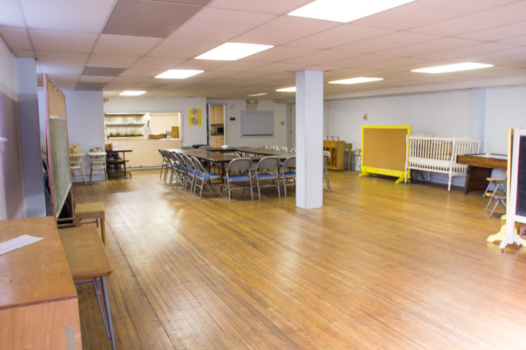 The community room's 1,160 square feet can accommodate many activities. The hall is adjacent to a modern kitchen.